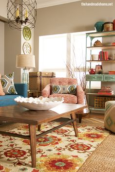 Love the patterns, colors, wooden pieces, and industrial accents! {The Handmade Home}