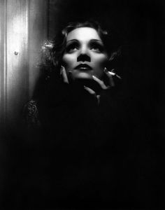 Traveling through history of Photography...Marlene Dietrich, by Josef von Sternberg who used butterfly lighting to enhance Dietrich's features, 1932. This photograph was cited by Mick Rock as the inspiration for the iconic Queen II album cover.