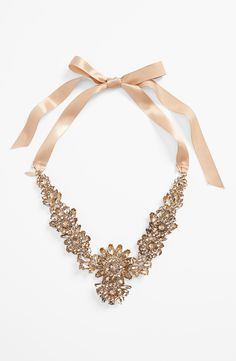 A glamorous ribbon tie statement necklace.