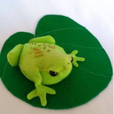 Funky Frog  Delightful beaded felt frog on a lily pad. Inspired by our western leopard toad in the Cape Peninsula. 11cm in size  www.peek.org.za