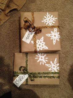 Burlap gift wrap with white snow flakes.