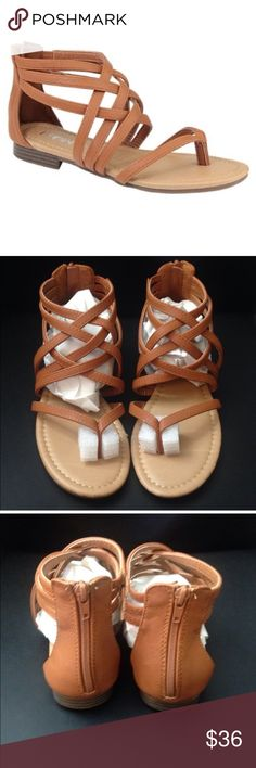 NWT Tan Strappy Zip Back Sandals 🎉HP🎉5 ⭐️RATED!!! Brand new in original box.  The perfect spring/summer sandal.  Faux tan leather strappy upper and zip up back.  Adorable comfy sandals.  Fits true to size. Shoes Sandals