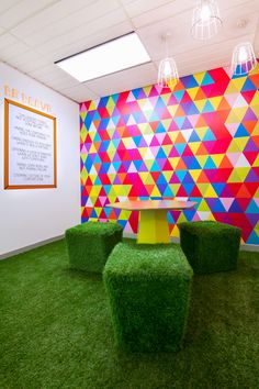 Mediacom | The Bold Collective | Office quiet room, informal meeting, astroturf, geometric wall graphic