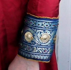 """A gorgeous design trim... If it was a manacle, the front of it would tighten and end before the wrist. (Original pinner stated this is part of a """"12th century silk tunic"""".)"""