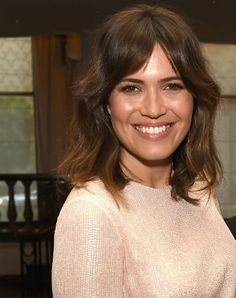 The 70's are BACK! The Shag made a strong appearance last year on runways and in magazines, but this year... celebs like Mandy Moore are pairing the shag with a heavy (center parted) fringe for a relaxed chic look.
