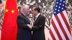 U.S. Secretary of State Rex Tillerson, left, and Chinese Foreign Minister Wang Yi stare at each other as they shake hands at the end of a joint press conference following their meeting at the Diaoyutai State Guesthouse in Beijing, China, Saturday, March 18, 2017.