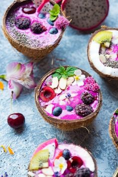 Dragonfruit Smoothie Bowls - super colorful Breakfast with fresh fruits and berries - served in a coconut. Summer feeling at the breakfast table
