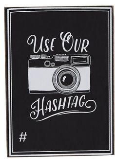 """Chalkboard wood plaque reminds guests to """"USE OUR HASHTAG"""" with space for personalization. Stands with dowel easel back."""