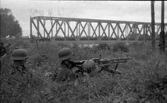 An MG-34 gunner crew in position near a bridge, Russia