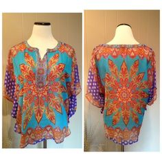 """Floral top New with tags gorgeous floral top. Loving these bright spring colors and so tempted to keep this beauty.  It is sheer and fits like a poncho. Brand is Valerie Stevens. Size S: 20""""UA, 24""""L in front, 27""""L in back. Valerie Stevens Tops Blouses"""