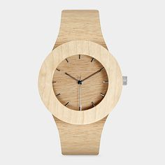 "Carpenter Watch, Lorenzo Buffa, 2013 Warm and rustic yet modern, the first soft-strapped watch made of all-natural wood —an understated, gender-neutral watch form. With an innovative bonded wood-and-leather strap made from lumber offcuts and a solid hardwood body, the timepiece is as beautiful as it is earth-friendly.  Made of maple and strap veneer made out of sliverheart off-cuts. Stainless steel hour markings. Made by craftspeople in Japan. Case: 1.66""diam."