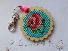 This vintage style keychain has been cross stitched onto a scolloped wood plaque, the clasp and key ring are attached by a co-ordinating pink ribbon. On the back I have finished the piece with pink felt and a blue heart gem. Lollipop Tree, Coming Up Roses, Tree Designs, Vintage Roses, Key Chain, Key Rings, Cross Stitch Patterns, Crochet Earrings, Vintage Fashion