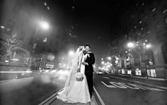 Black and White Photo of Bride and Groom in Chicago Street     Photography: Carasco Photography  @carascophoto http://www.carascophoto.com  Gown: Matthew Christopher http://www.matthewchristopher.com  Planning: Kesh Events http://www.keshevents  Floral: Kesh Designs http://www.keshdesigns.com  Makeup: Makeup by Aga http://www.makeupbyaga.com  Read More:  http://www.insideweddings.com/weddings/new-york-yankees-infielder-marries-in-opulent-chicago-soiree/764/