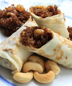 Alle Belle  Ingredients:  175 gm flour (maida)  5 eggs  25 gm castor sugar  40 ml sunflower oil  15 gm cashew nuts (broken)  500 ml milk  250 gm fresh coconut (grated)  100 gm black jaggery  15 gm raisins  Salt to taste