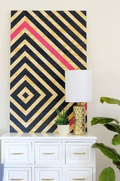 DIY Wall Art – Super easy, just plywood, painters tape and some paint! Great impact for low price!