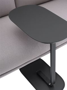 The Relate Side Table is an elegant design with two planes, connected through a graphic leg for a modern expression.
