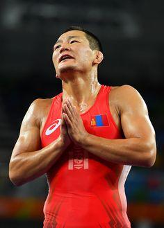 Mandakhnaran Ganzorig of Mongolia reacts following his defeat to Ikhtiyor…