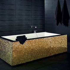 Luxury Bathroom with black and gold color scheme | Golden bathtub mosaic with black and gold color schemes evoke a luxury appeal in interior design. The two compliment each other, and in the bathroom they are especially powerful. Mosaic with 14k gold leaf. ➤To see more Luxury Bathroom ideas visit us at www.luxurybathrooms.eu #luxurybathrooms #homedecorideas #bathroomideas @BathroomsLuxury