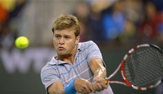 Ryan Harrison returns a shot to Nadal