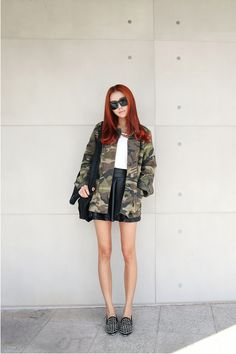 Camouflage Utility Jacket with leather skirt and studded flats.
