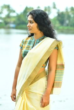 This contemporary take on the traditional rouka has buttons and a string tie at the front of the blouse. Made from the ubiquitous lungi this blouse is defini...