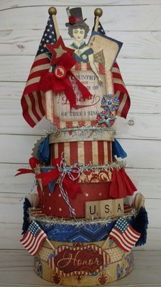 An altered cake created by Brenda Enright using Character Constructions Doll Stamps by Catherine Moore. Doll is from the Cirque Collection.
