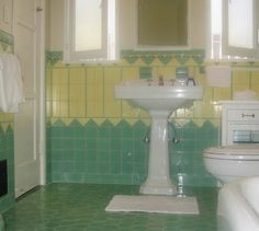 Beautiful Yellow and mint green vintage tile bathroom from the 1930s pic