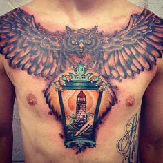 Small owl tattoo with big wings on back