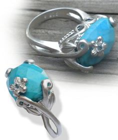 50% off retail www.neelys.storenvy.com Use Coupon Code neelys50 at checkout Sterling Silver with faceted Turquoise set in flower prongs Size 6, 7, 8,  9, 10