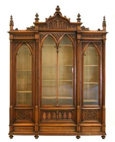 An exceptional American Victorian walnut gothic bookcase...