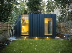 Shadow Shed Garden Room by Neil Dusheiko Architects. Situated at the end of the garden of a Victorian house in Camden, the design had to respond to the limitations of a conservation area, the close proximity of trees and surrounding neighbours.