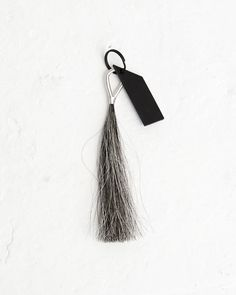 Silver Wire Grey Tassel