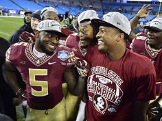 The Florida State Seminoles celebrate after winning the ACC Championship on 12/6/14.