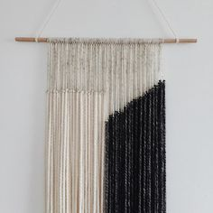a beautiful modern yarn wall hanging for any room in your home. Dimensions: Stick width 18in Yarn width 14.5in Yarn length 30in Due to delicacy of yarn, item is rolled tightly to avoid tangling and may arrive slightly wavy on the ends.