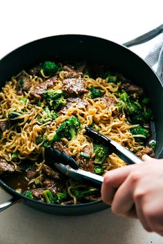 Skillet Beef And Broccoli Ramen With Vegetable Oil, Minced Garlic, Red Wine Vinegar, Honey, Low Sodium Soy Sauce, Flank Steak, Corn Starch, Sesame Oil, Brown Sugar, Ginger, Beef Broth, Oyster Sauce, Broccoli Florets, Ramen Noodles, Salt, Pepper, Green Onions, Red Pepper Flakes, Sesame Seeds
