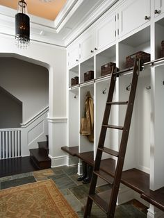 Mud Rooms Design, Pictures, Remodel, Decor and Ideas - page 7  A nice ladder so you can reach items in the upper storage- and not have everything fall on your head!