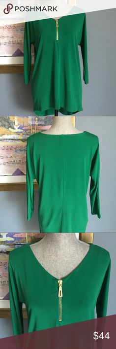Chelsea & Theodore Blouse Beautiful green Chelsea & Theodore hi-low silky knit blouse .  Features a gold front zipper with chunky zipper pull .  Nice amount of stretch .  Made of 95% polyester/5% spandex .  Machine wash/dry . Chelsea & Theodore Tops Blouses