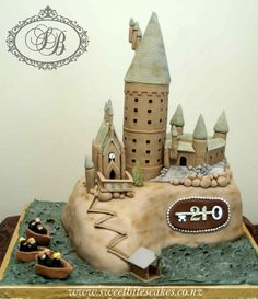 Hogwarts cake---complete with the boathouse from movie #8!