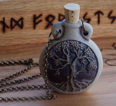 OLD WORLD MAGICK Potion Bottle Pendant Necklace 24' Bronze Chain - Your Choice - Skull, Celtic Knot, Faerie, Pentacle, Tree of Life, Wolf. $21.95, via Etsy.