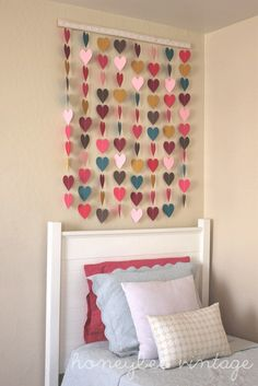 Honeybee Vintage: DIY: Paper Heart Wall Art, little girls bedroom. I'm not a huge fan of hearts but it could be anything
