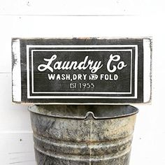 Farmhouse Laundry Decor | Laundry Sign | Laundry Room Decor | Laundry Room Sign | Wash Dry Fold | Laundry Today | Naked Tomorrow | Vintage Wall Hangings. Fresh off the wagon folks!! Our NEW Laundry Decor Signs are a must have for every farmhouse laundry room. A beautiful black wash with white lettering. Designed & handcrafted by Three Arrows. We use non toxic acrylic paint (NO STICKERS) Wall hook on back for easy hanging! Choose individual sign or the entire set! 8x15x.75 inches PLEASE…