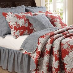 Outfit your master suite or guest room in country-chic style with this charming cotton quilt set, showcasing a reversible floral and gingham motif. ...