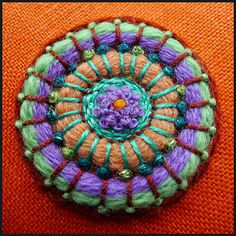 Embroidery piece for a button stitched with wool and Perle 8 by Birthine on Flickr.