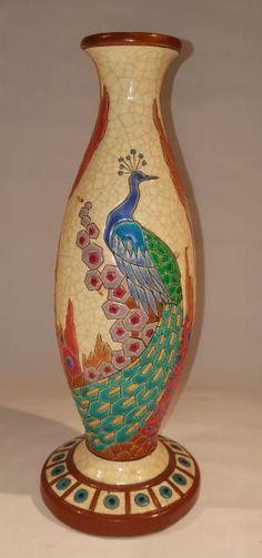 Manufacture de LONGWY (XX) Vase soliflore en grès craquelée à décor d'un paon, de cyprès et d'arbres stylisés polychrome  Cachet dela manufacture sous la base  H. 28,5 cm - Millon - 17/02/2017