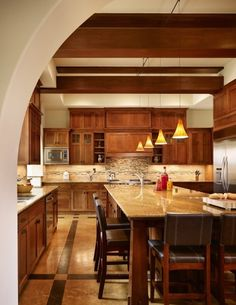 Love this craftsman style kitchen and flooring