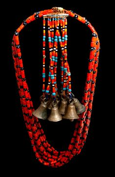 100+ Years Old!    Worn by shaman from ancient tribes of India and Tibet close to the Myanmar border, these necklaces were used in ritual dances to awaken the Gods. Each bell has a different tone and the unique use of design and color distinguishes the tribe.  From London Coin Galleries