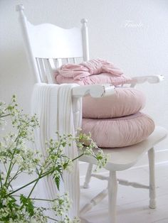 pink pillows white chair