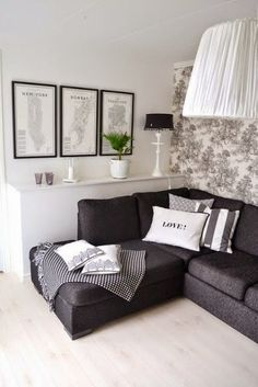 Nice living room idea with dark grey couch and light accents