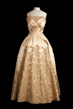 fripperiesandfobs:  Evening dress designed by Norman Hartnell for Queen Elizabeth II, 1950's From Kensington Palace via My London Life