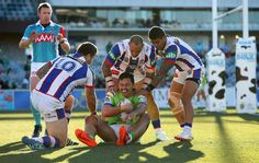 Jordan Rapana of the Canberra Raiders is tackled in goal during the round 17 NRL match between the Canberra Raiders and the Newcastle Knights at GIO Stadium on July 3, 2016 in Canberra, Australia.